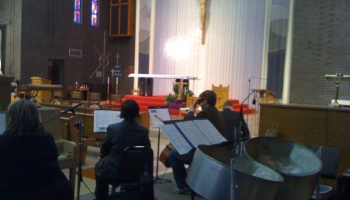 Set up with a cello, violin and piano at a church in Park Forest